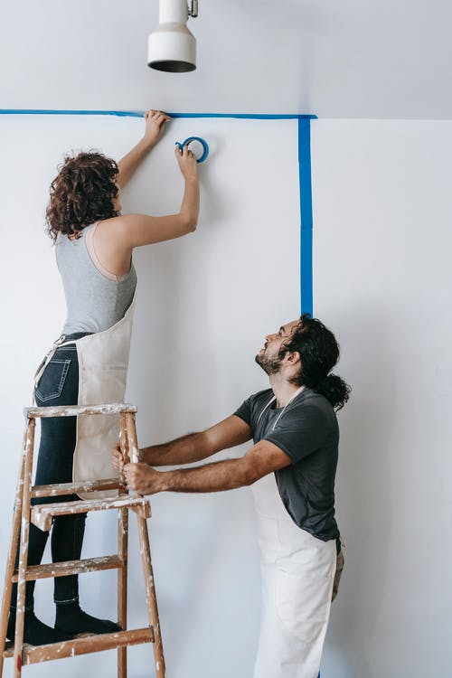 Couple Fixing Their House