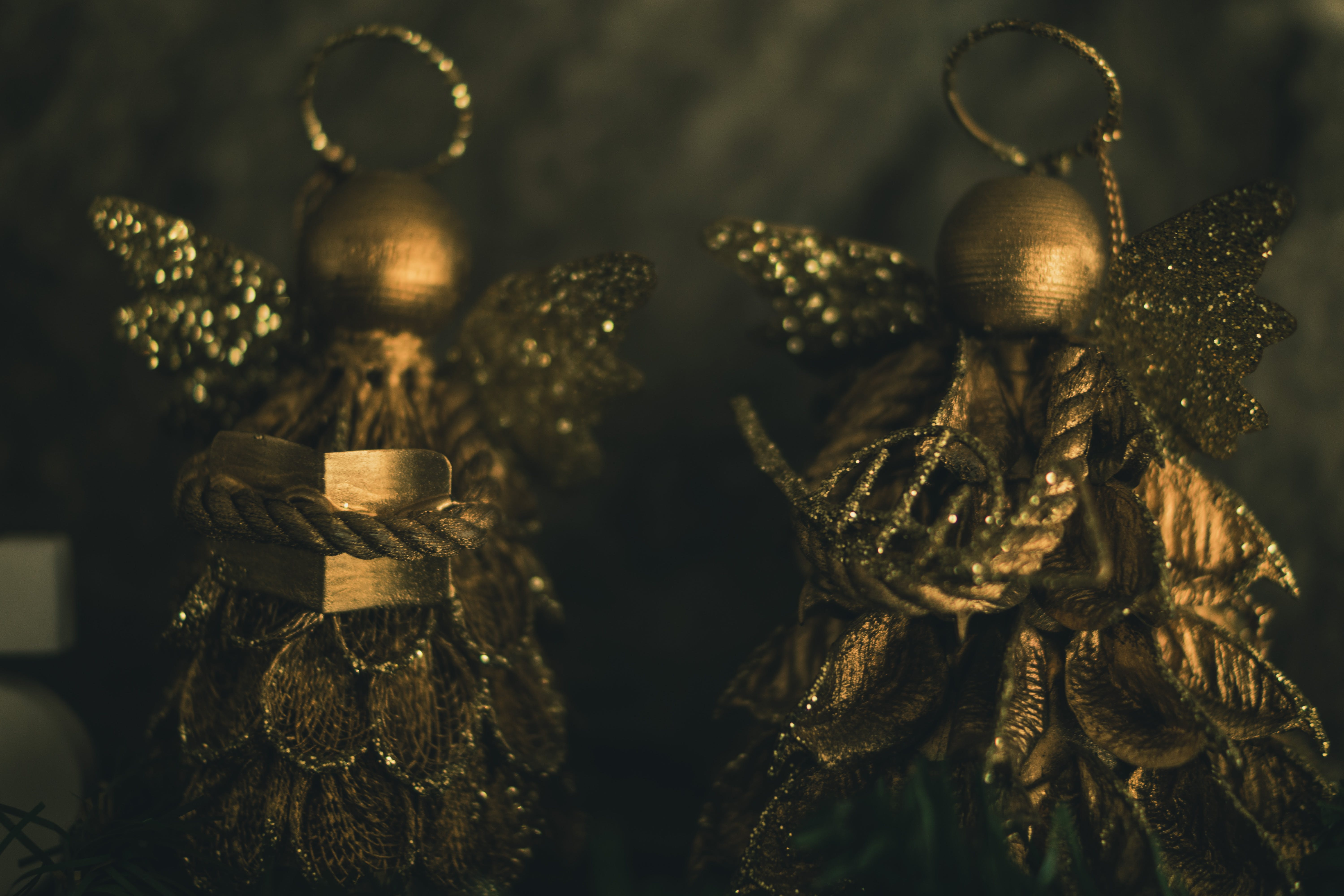 Two Gold-colored Christmas Decorations