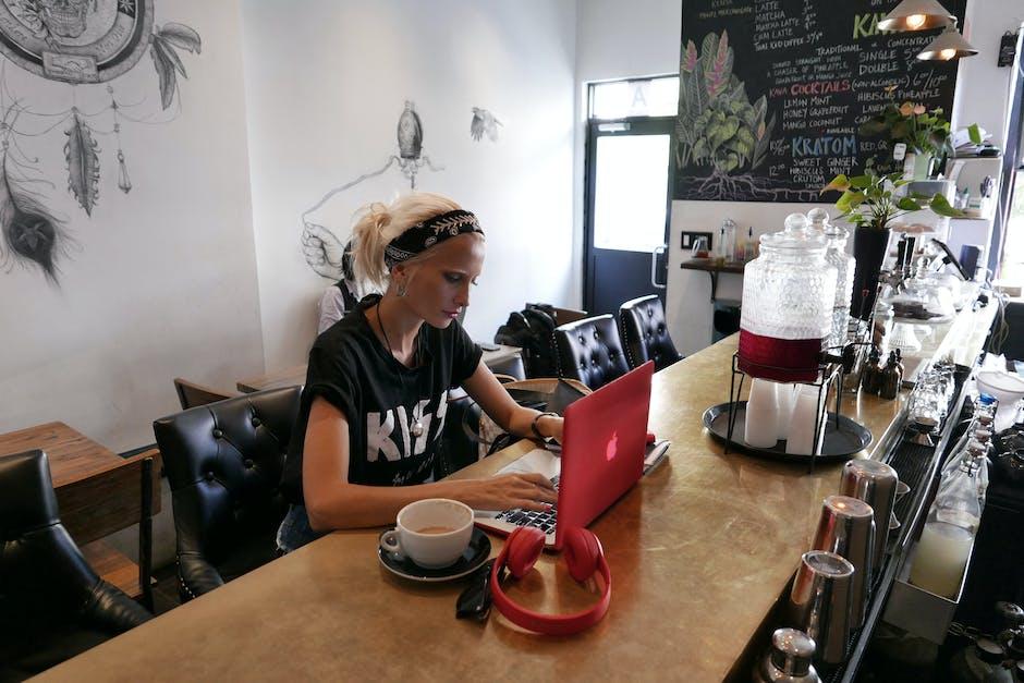 Woman Wears Black Kiss Print Crew-neck Shirts Sits
