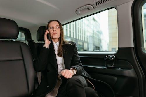 A Woman in Black Blazer Talking on a Cellphone