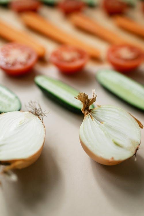 Cut Vegetables on Beige Background