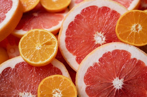 Plat Lay Photography of Sliced Oranges and Grapefruit