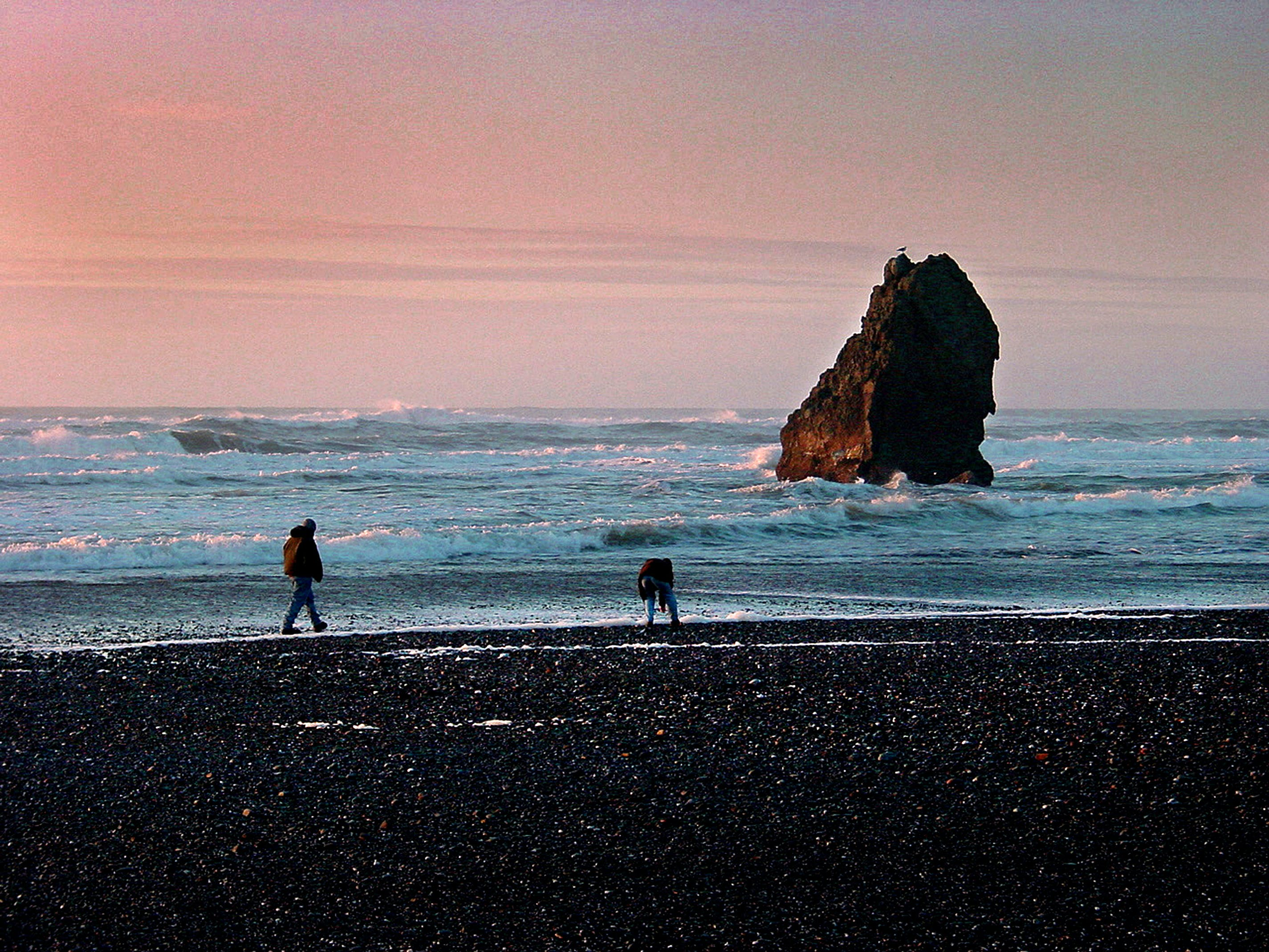 Two People at the Seashore during Dawn