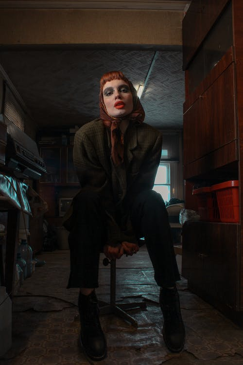 Cool woman with makeup in house room