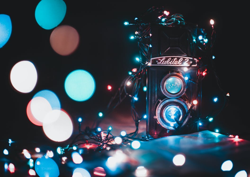 Black and Grey Lubitel 2 Camera Covered With String Lights