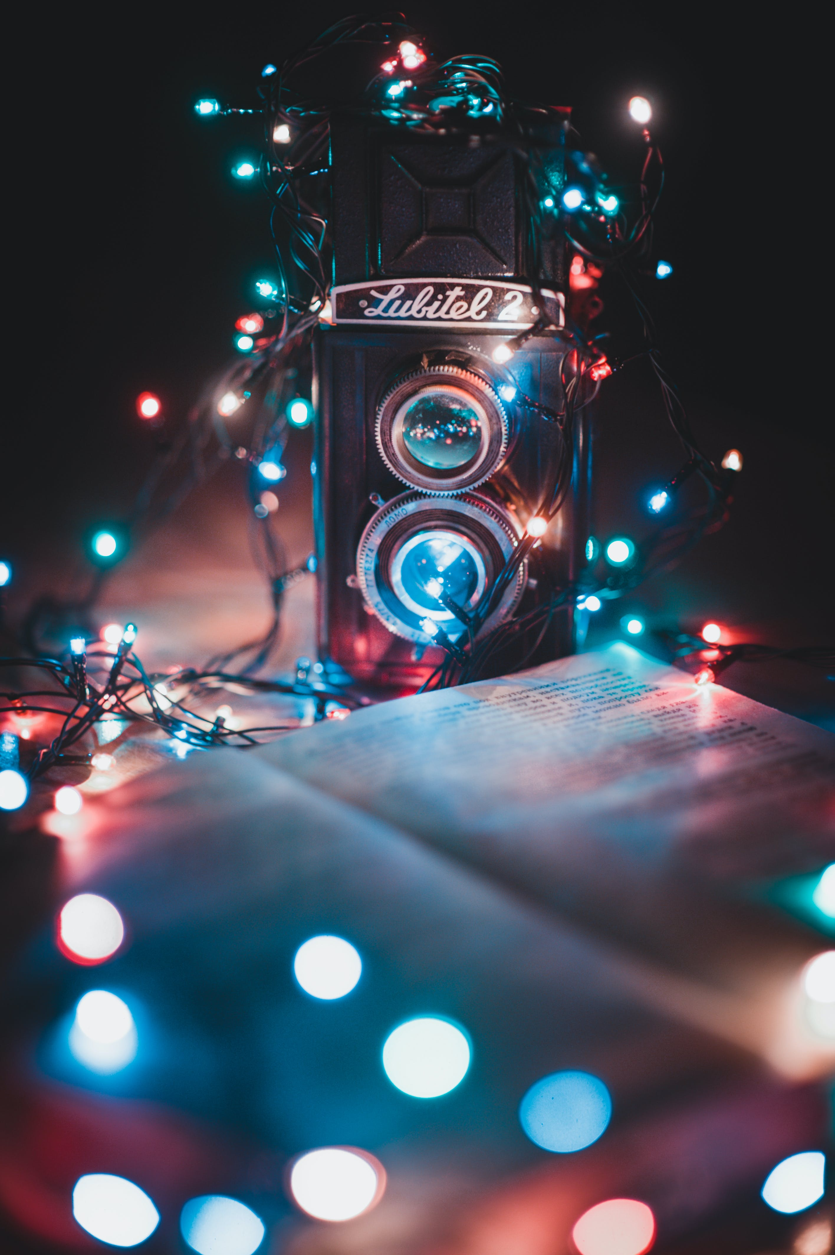 Turned-on String Lights Surrounded the Dual-lens Reflex Camera