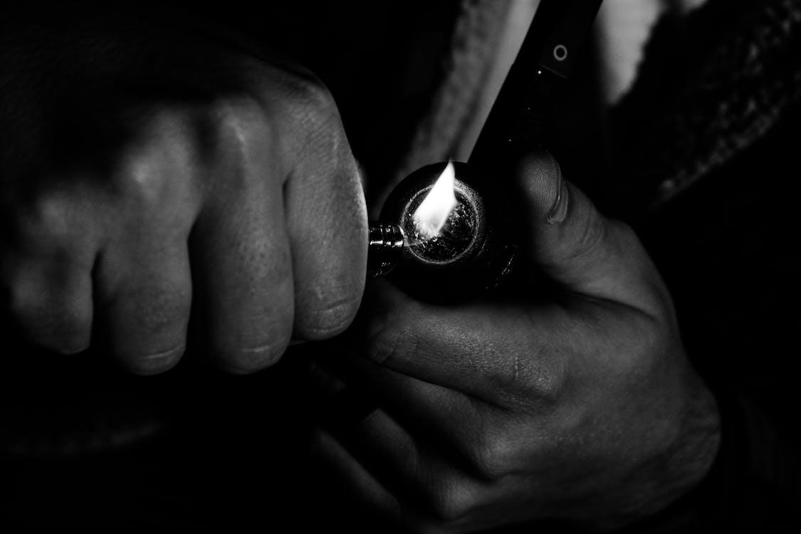 Photo of Man Holding Lighter