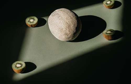 Brown Round Hat on Black Table