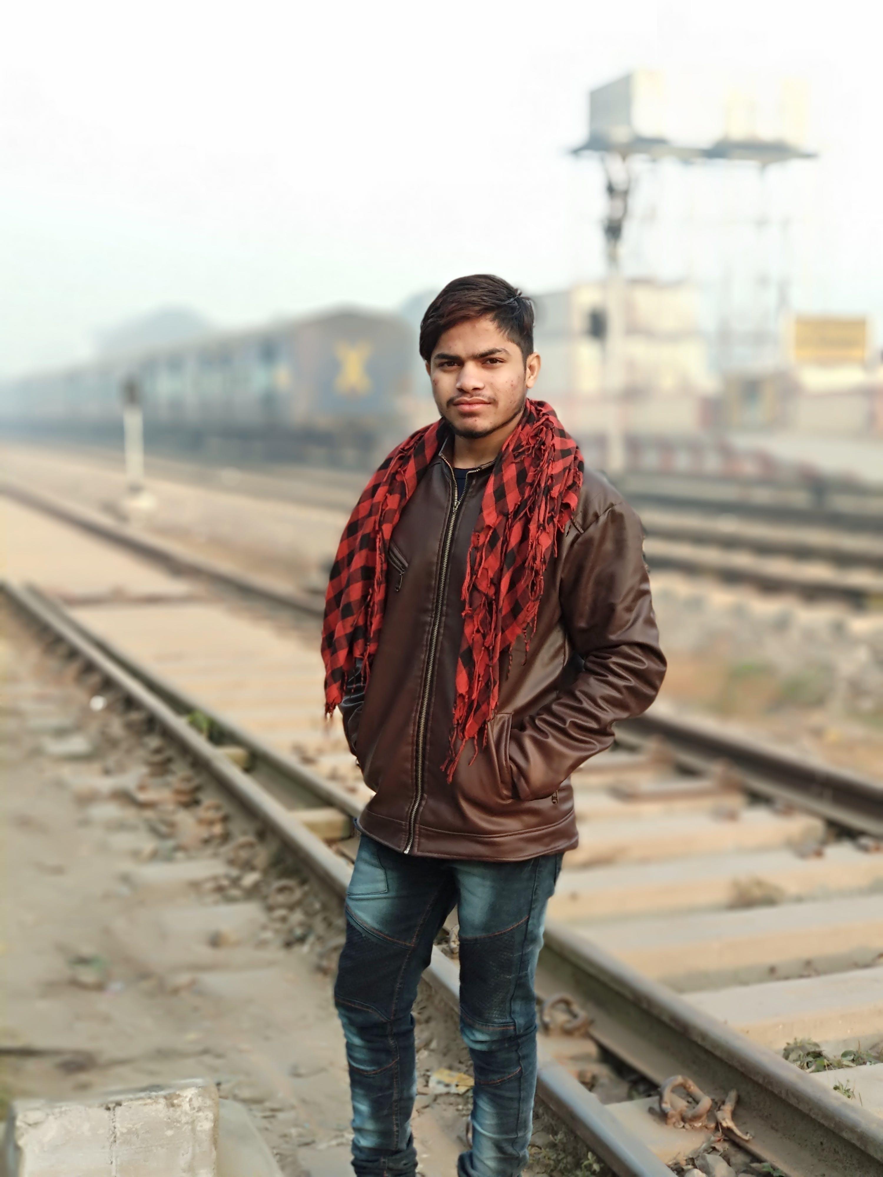 Man Wearing Brown Full-Zip Jacket