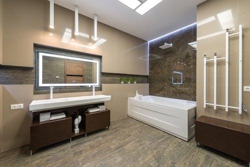 Stylish bathroom with white bathtub