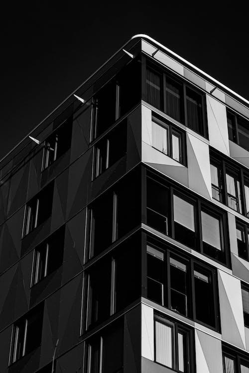 Grayscale Photo of Concrete Building