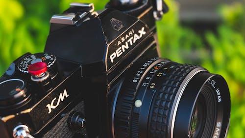 Black Nikon Dslr Camera on Green Grass