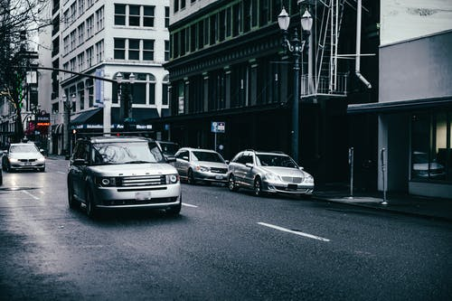 Cars Parked on Side of the Road in Grayscale Photography