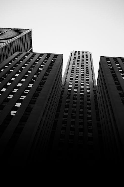 Foto profissional grátis de aço, arquitetura, arranha-céu, arranha-céus