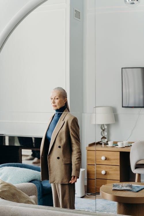 Elderly Woman in Brown Suit