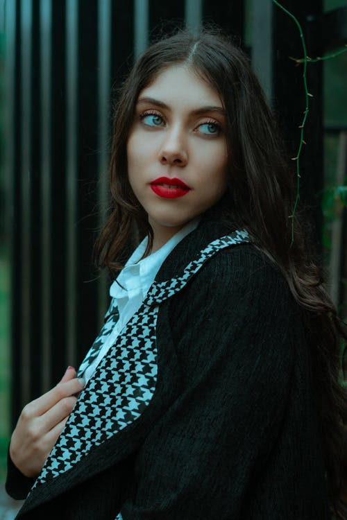 Woman in Black Cardigan and White and Black Polka Dot Shirt