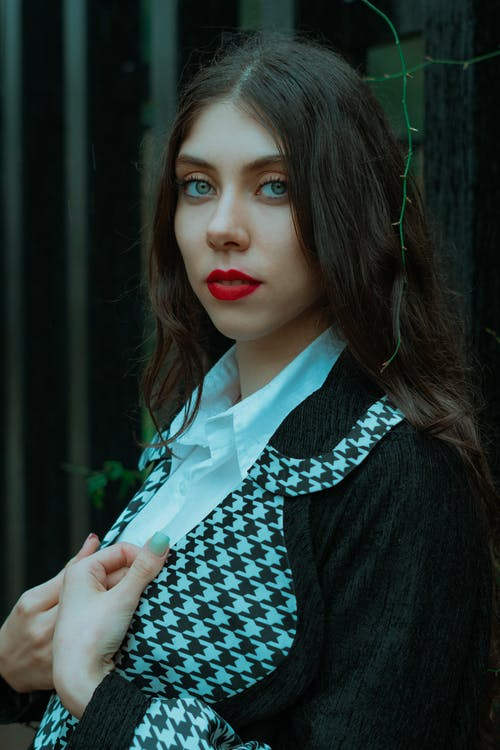 Woman in Black and White Collared Shirt