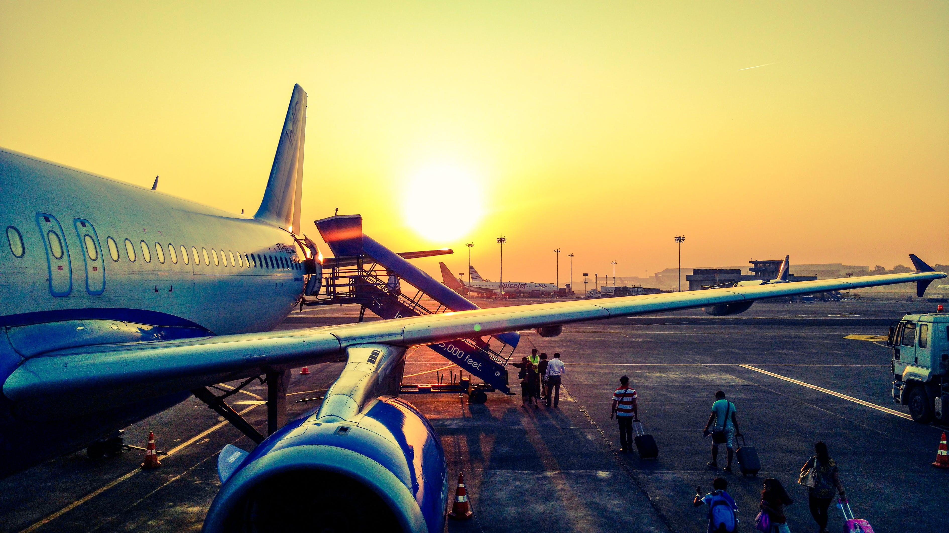 Photography of Airplane during Sunrise