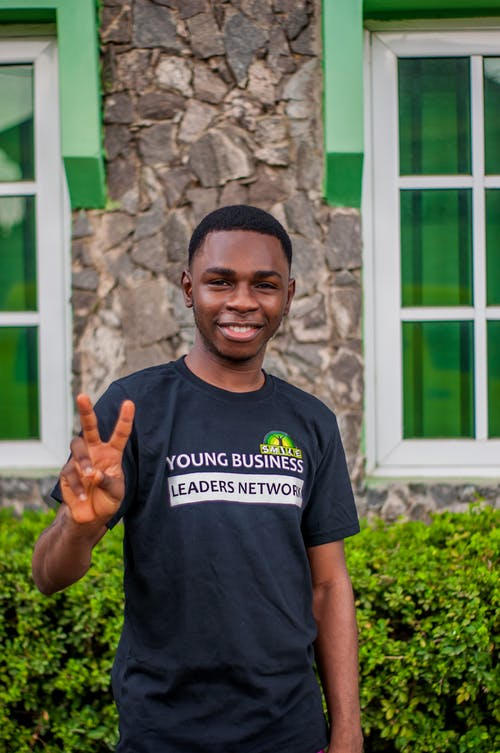 Young Man Posing with Peace Sign