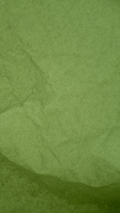 Green Textile on Brown Wooden Table