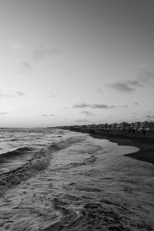 Foamy wavy sea on city shore