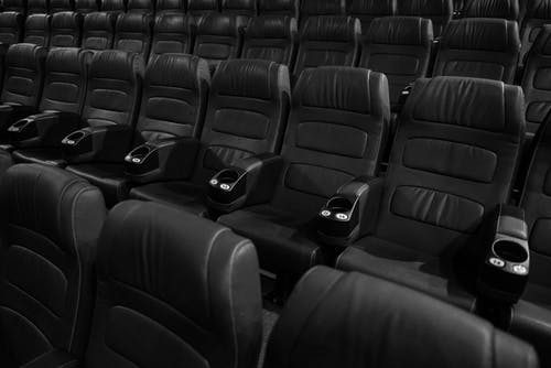 Grayscale Photo of Empty Seats in Movie Theater