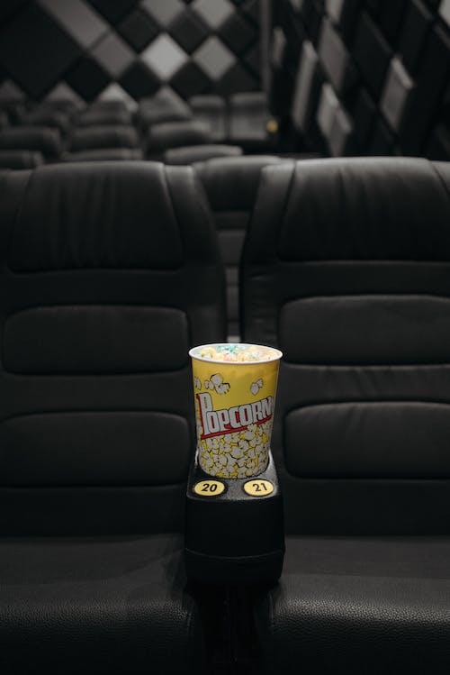 Bucket of Popcorn on the Armrest