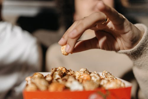 Person Holding White and Brown Food