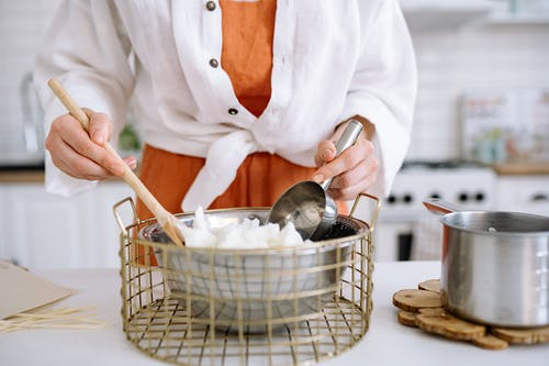 Person Preparing Soy Wax For Candle