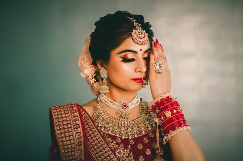 Gorgeous Indian woman with bright accessories in traditional clothes