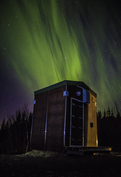 Photo of Wooden Shed Under Northern Lights