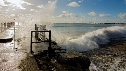 Photos gratuites de briseur, faire signe, jetée, mer