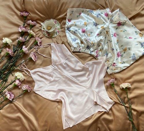Pajamas with flowers on brown blanket