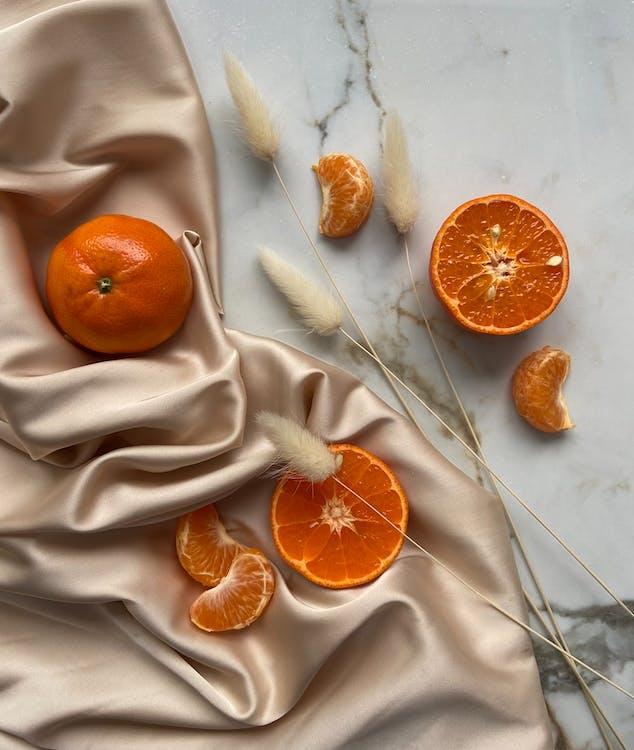 Oranges and tangerine on textile