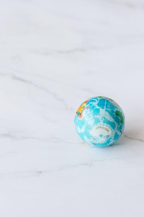 Globe on White Surface