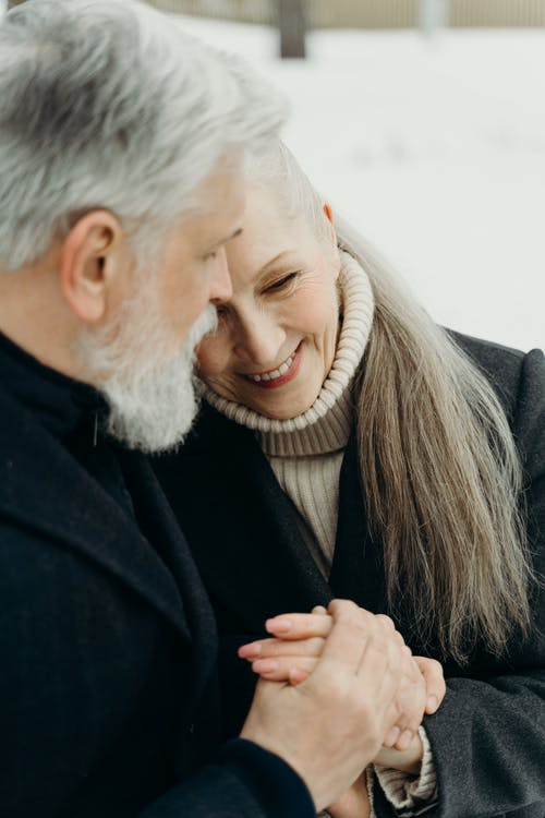 Close-Up Shot of an Elderly Couple Embracing