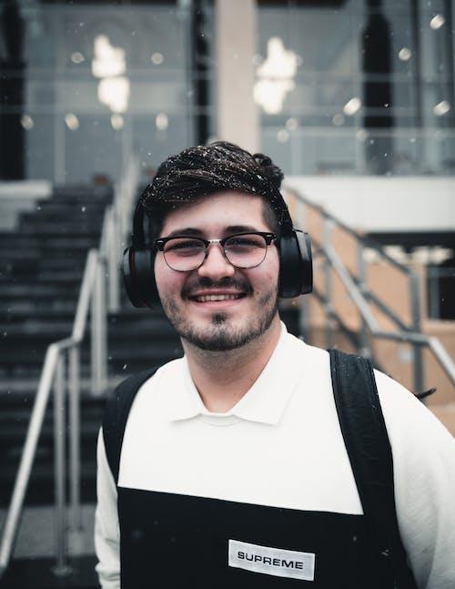 Man Wearing Headset and Smiling