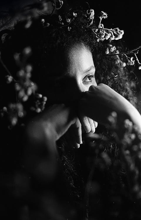 Black woman surrounded with gentle flowers