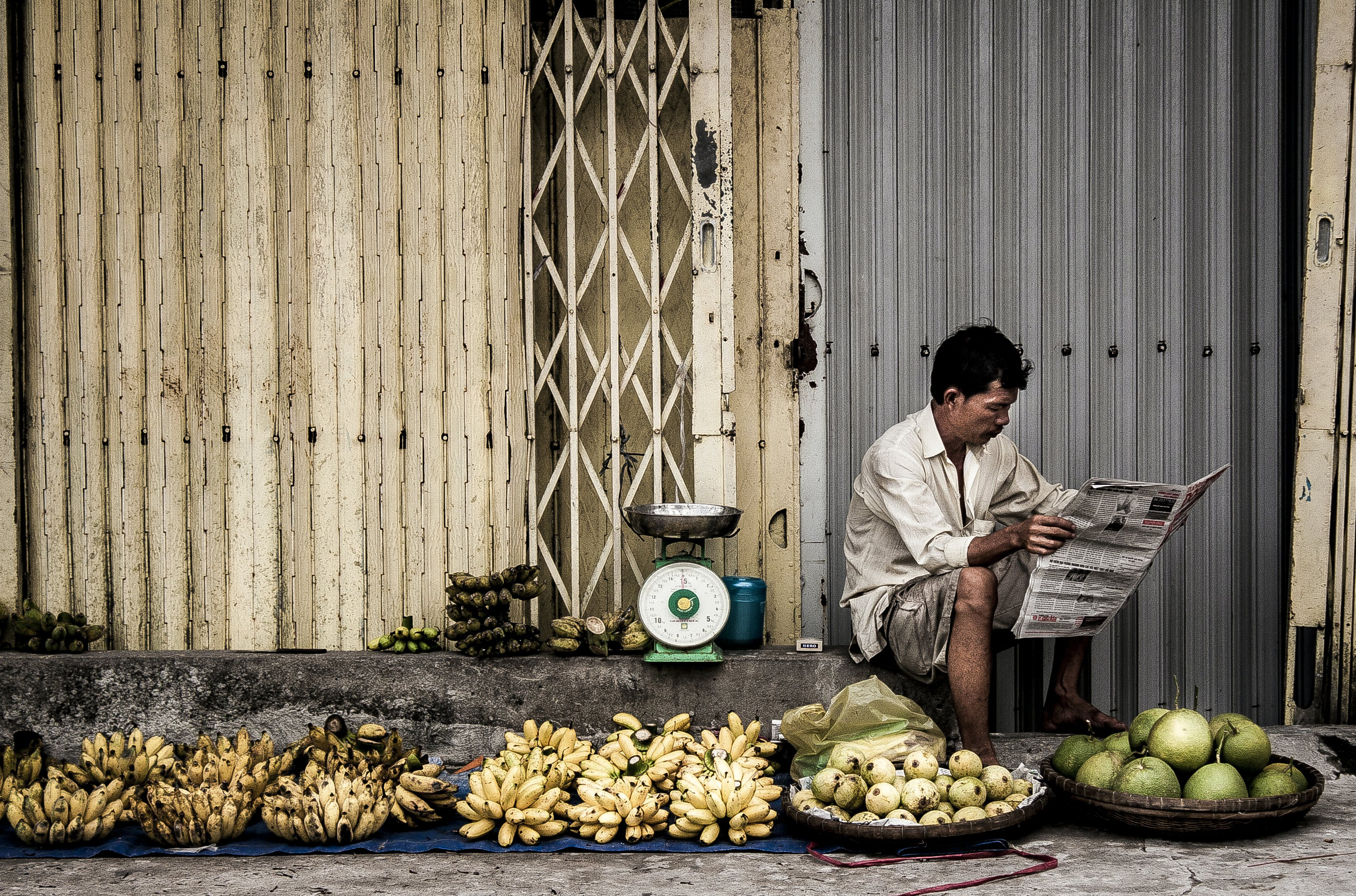 Man Sitting Near Fruits