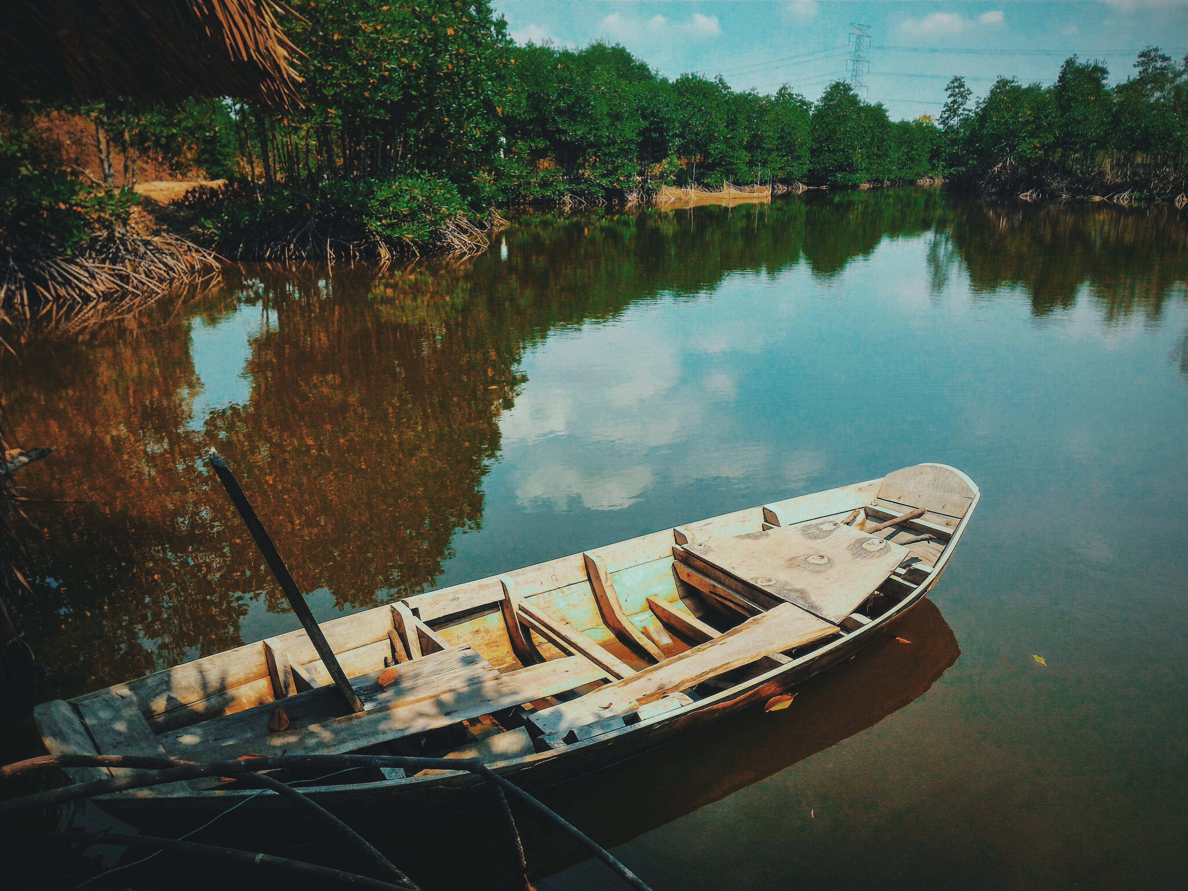 Brown Canoe Boat on Body of Water