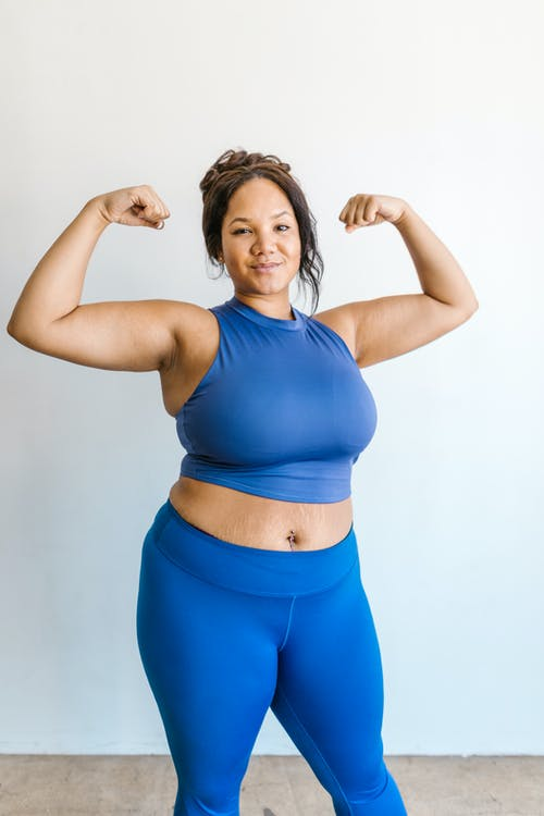Woman in Blue Sports Bra and Blue Shorts
