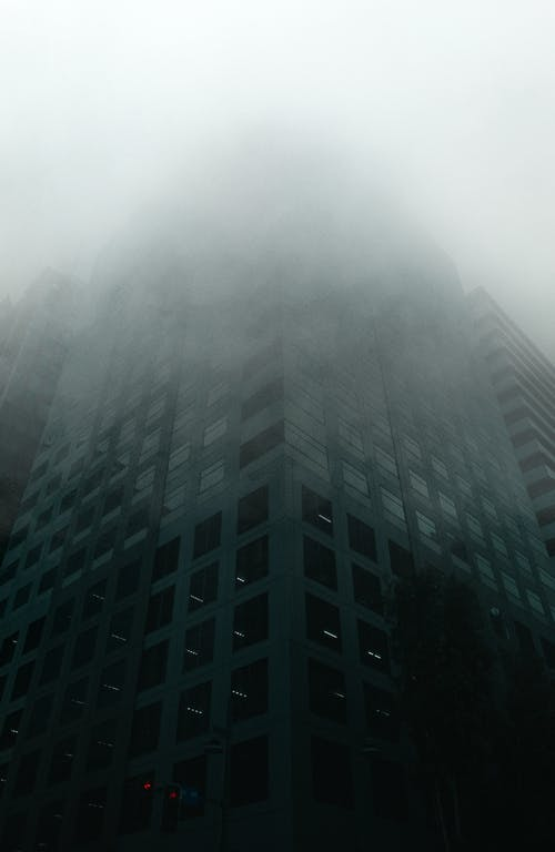 Modern multistory building in foggy weather