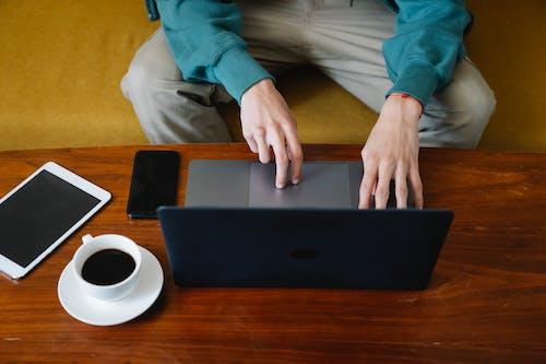 Man surfing laptop during remote work at home