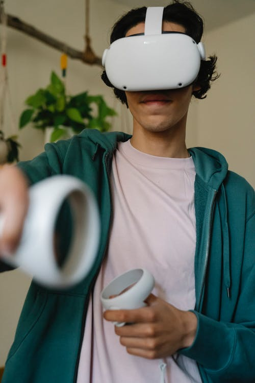 Gamer in VR headset playing video game in room