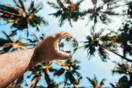 Close-Up Shot of a Person Holding a Lensball