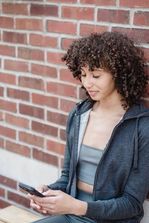 Kostenloses Stock Foto zu afro, aktivbekleidung, athlet