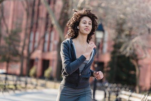 Active ethnic runner training in park