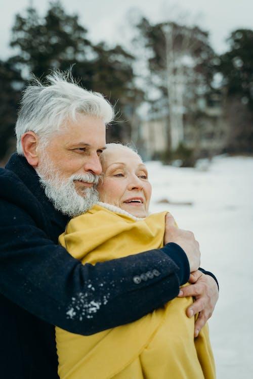 Elderly Couple Hugging