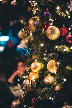 Green and Gold-colored Lighted Christmas Tree