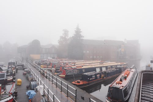 Ships moored in port in foggy weather